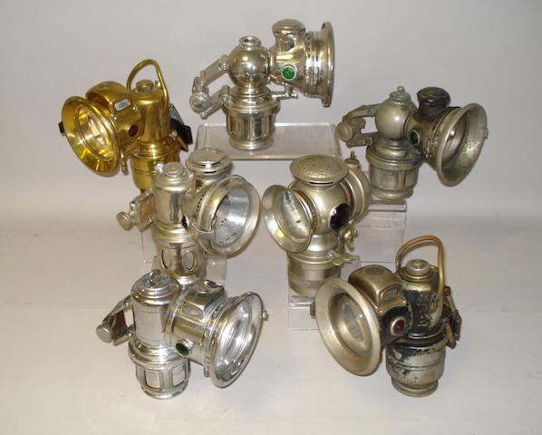 Seven acetylene cycle lamps,