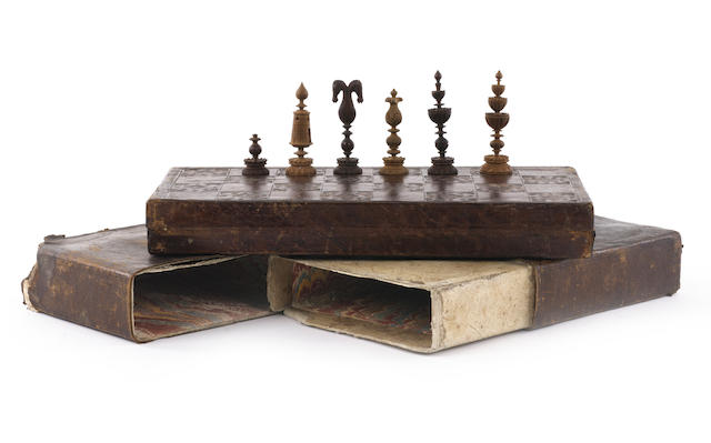 A carved boxwood and leather-cased travelling chess set, German, 18th century,