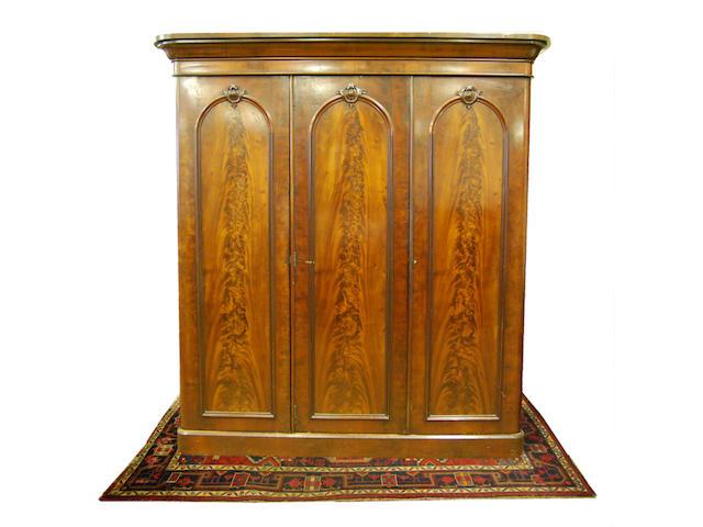 A mid-Victorian mahogany triple wardrobe