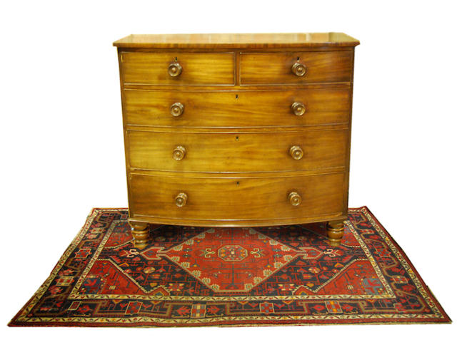 A mahogany bow-front chest of drawers, early 19th Century