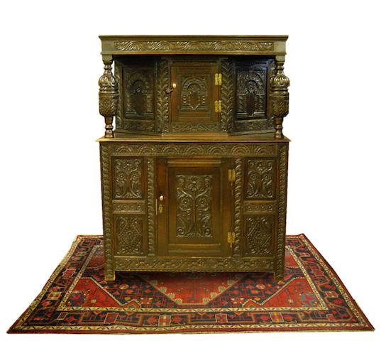 An oak court cupboard, in 17th Century style