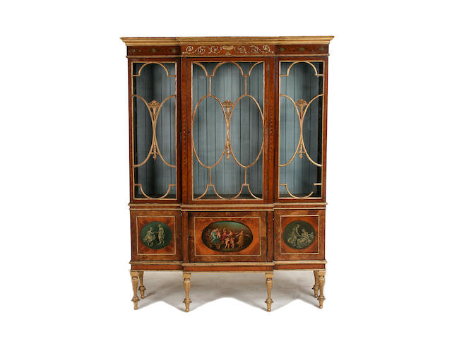 A good Sheraton style satinwood, parcel gilt and polychrome decorated display cabinet