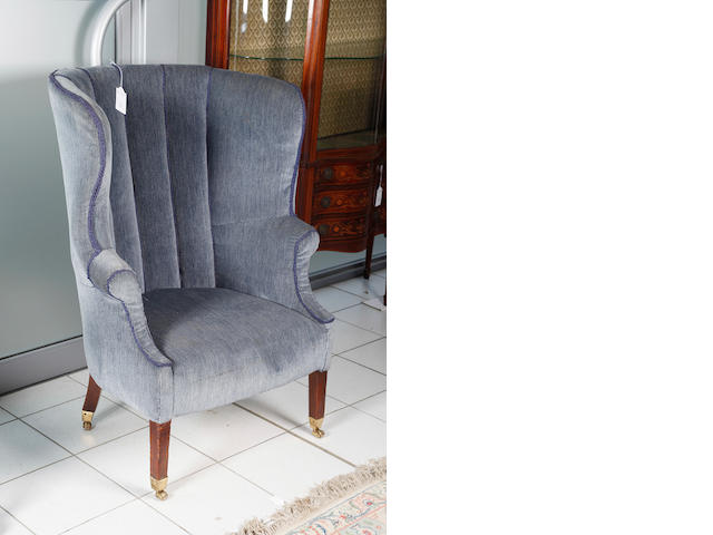 A Georgian wing back easy chair