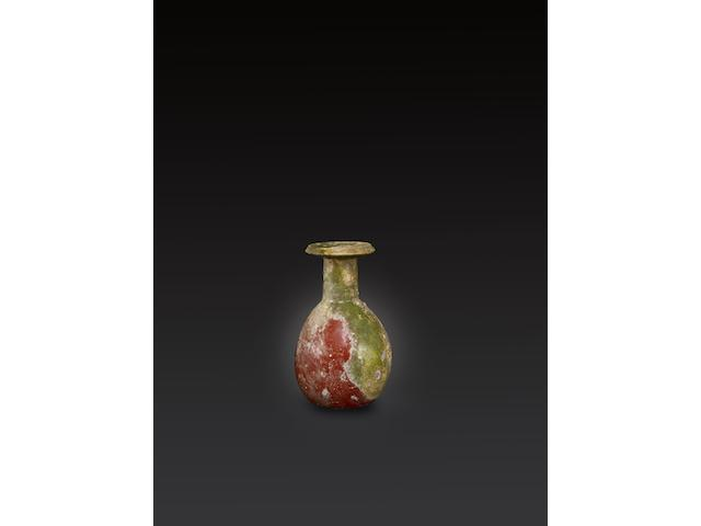 A Late Hellenistic - Early Roman opaque red glass bottle