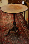 A George III mahogany tripod wine table