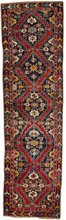 A Karabagh runner South West Caucasus, 12 ft 7 in x 3 ft 8 in (383 x 110 cm)