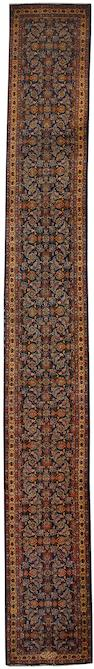 A narrow Tabriz runner North West Persia, 17 ft 7 in x 2 ft 3 in (535 x 68 cm)