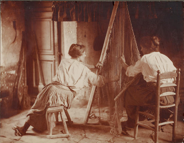 Circle of Frank Meadow Sutcliffe (British, 1853-1941) Mending the nets sepia toned photograph 23 x 29cm. (unframed)