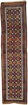 A North West Persian runner 12 ft 11 in x 3 ft 4 in (393 x 101 cm)