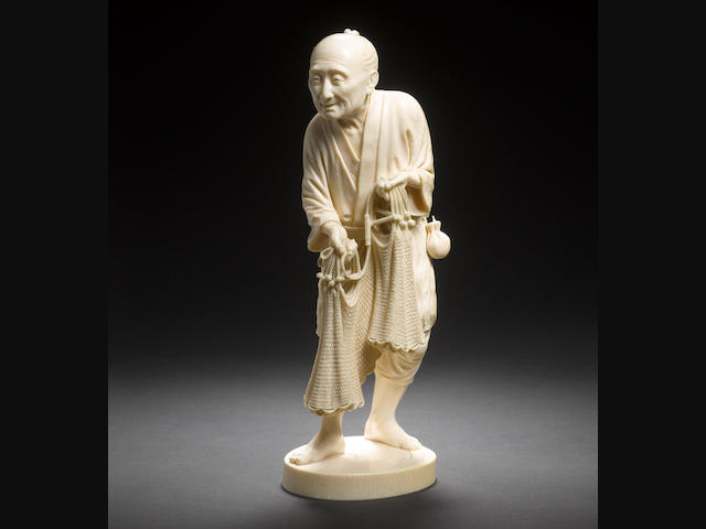 A Tokyo school ivory figure of a a fisherman By Kozan, Meiji Period