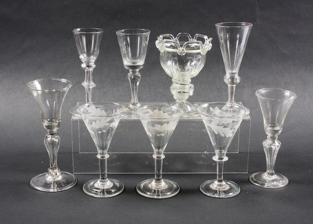 Four light-baluster wine glasses, a sweetmeat, three engraved glasses and another Circa 1750-60 and later.