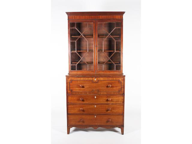 A composite late George III mahogany secretaire bookcase