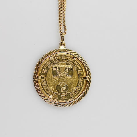 A coin set pendant, The coin claw mounted, on chain.