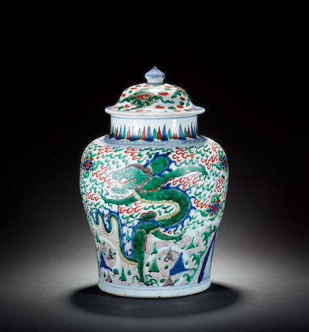 A Transitional wucai vase and domed cover with knop finial 17th century