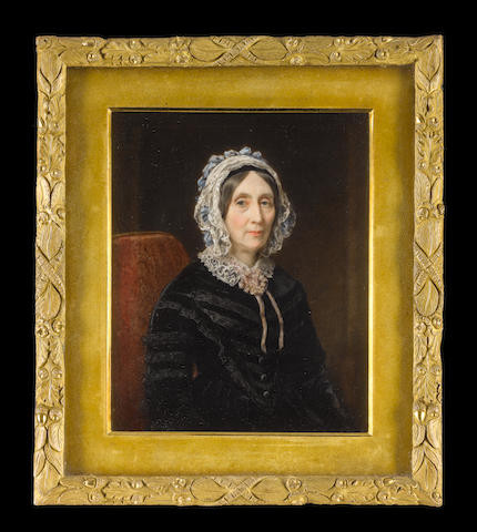 Sir William Charles Ross, RA (British, 1794-1860) Jane Hawker, Lady Seymour (d.1852), seated in a red upholstered chair, wearing black velvet dress trimmed with ribbon, white lace collar held with rosette of pink ribbon, black ribbon bandeau and white lace headdress decorated with blue ribbon