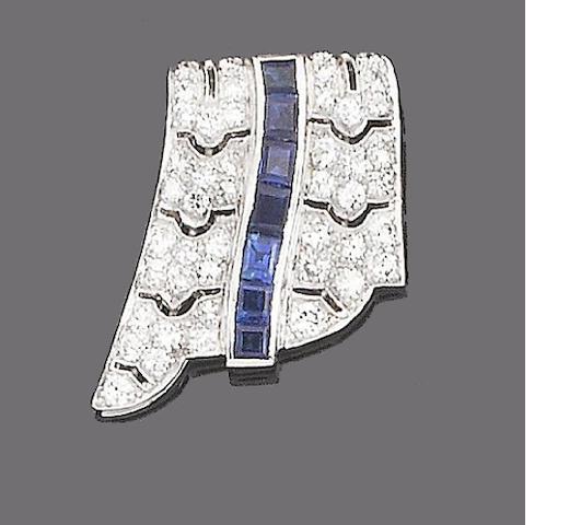 A sapphire and diamond clip brooch