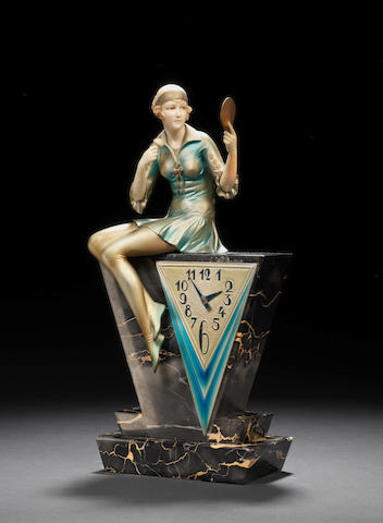 Ferdinand Preiss 'Powder Puff' a rare Art Deco cold-painted bronze and carved ivory Figural Clock, circa 1925