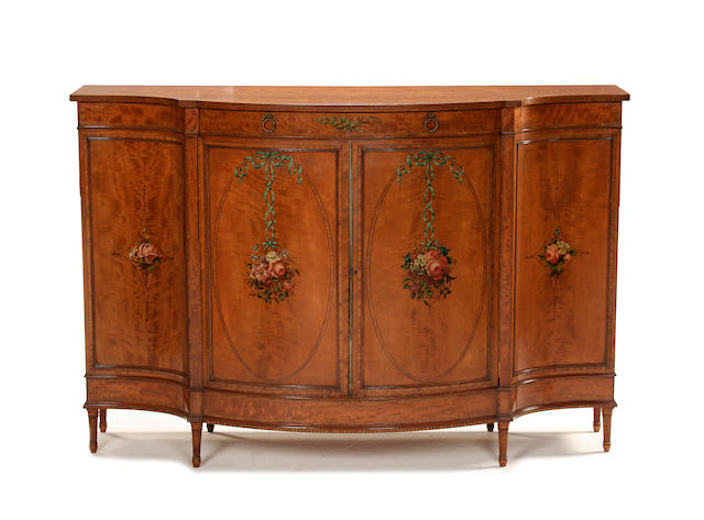 A George III style satinwood, tulipwood and polychrome decorated side cabinet by Warings