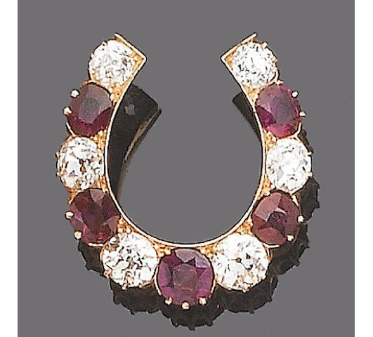 A late 19th century ruby and diamond horseshoe brooch