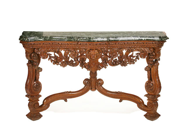 A pair of first half 20th century carved fruitwood serpentine console tables in the Baroque style