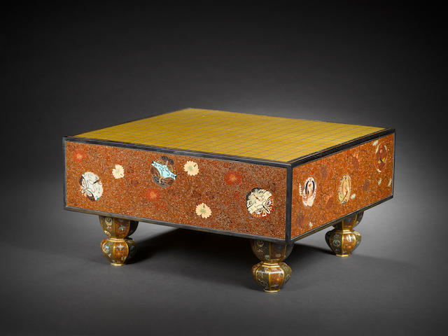 A cloisonné enamel go board with a wood storage box By Honda