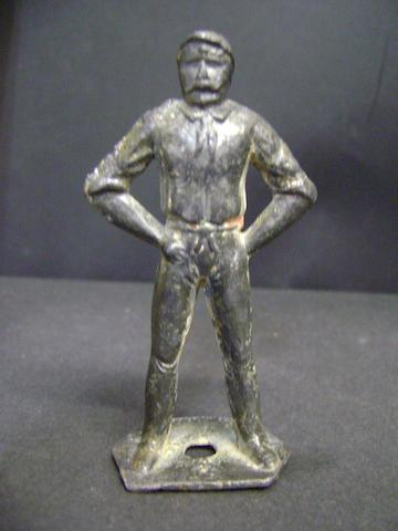 A mid 19th century lead figure of a bowler