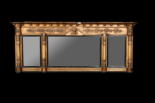 A late Victorian giltwood and composition overmantel mirror
