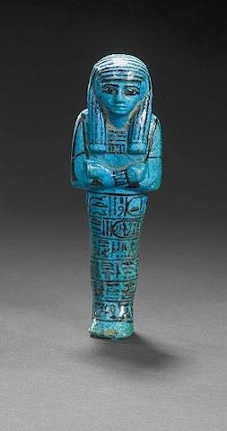 An Egyptian bright blue glazed composition royal shabti