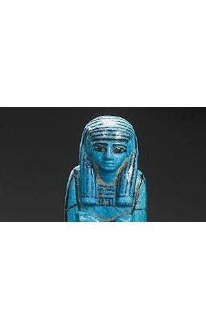 An Egyptian bright blue glazed composition royal shabti