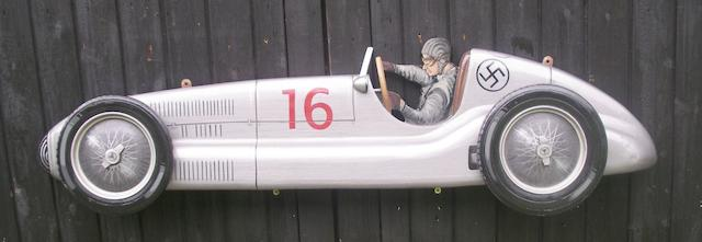 A hand-painted wooden profile of a Mercedes W125,
