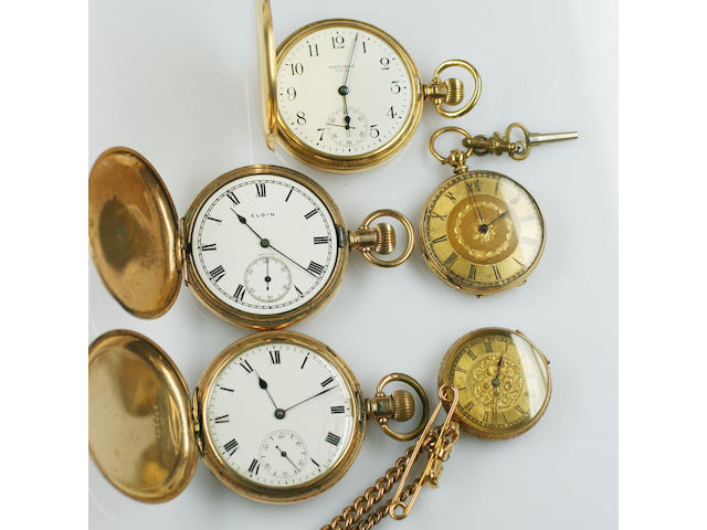 An 18ct gold case hunter pocket watch, by Waltham USA hallmarked for Birmingham 1927, inscribed, two late 19th Century 18ct gold fob watches, in foliate engraved cases, one suspended from a tied ribbon bow bar brooch, a 9ct gold curb link watch chain with 'T' bar and two rolled gold hunter pocket watches. (6)