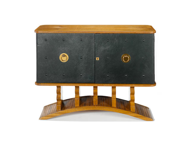 Laszlo Hoenig, a sideboard, circa 1945 walnut and leather with brass fittings