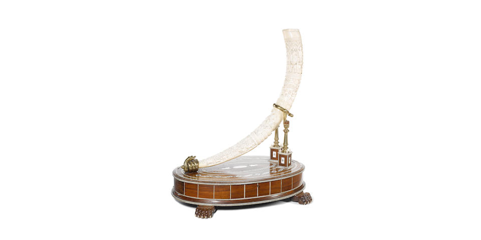 An early 20th century carved ivory and rosewood lightstand
