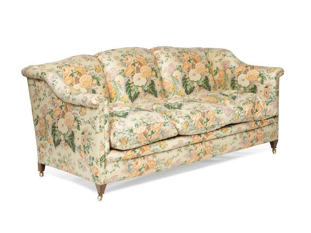 A 20th century mahogany three seat sofa