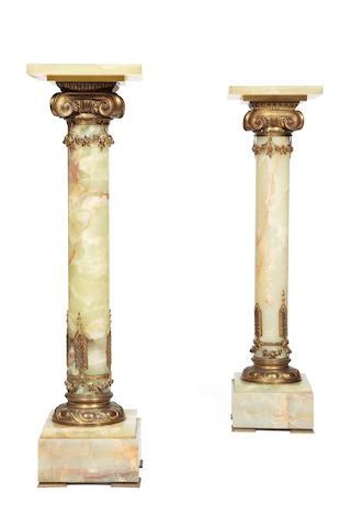 A pair of French onyx and ormolu pedestalsCirca 1900