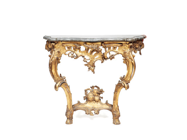 A 19th century rococo style giltwood and marble topped pier table