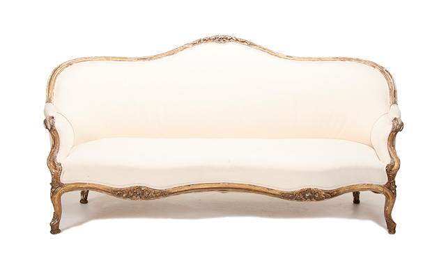 A mid 19th century carved giltwood sofa