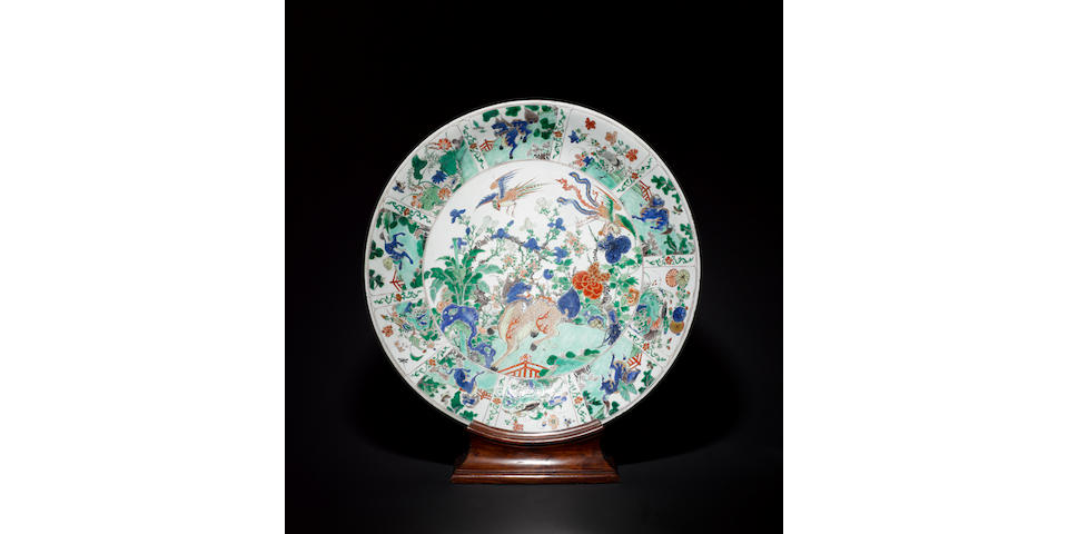 A large famille verte plate with wood stand
