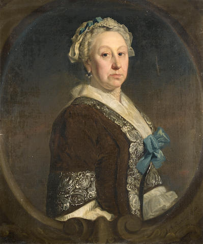 Circle of Allan Ramsay (Edinburgh 1713-1784 Dover) Portrait of Grace Ward, third daughter of the Cheif Baron Ward, half-length, in a brown dress and white chemise, within a painted stone cartouche