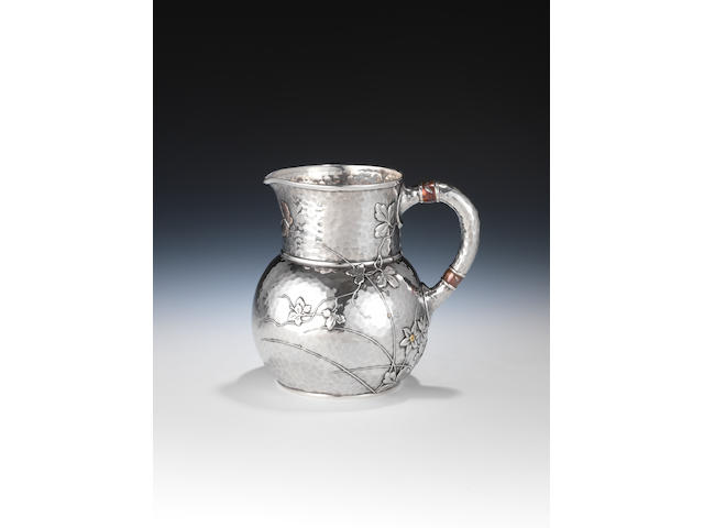 "A late 19th century American silver and mixed metals pitcher, by Tiffany & Co., New York, the base incuse stamped ""Tiffany & Co.,"" over ""3077 makers 1305"" over ""Sterling Silver and other metals"", over ""751"","