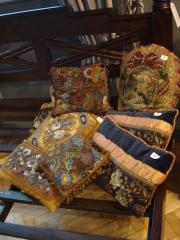 A collection of eight various beadwork cushions