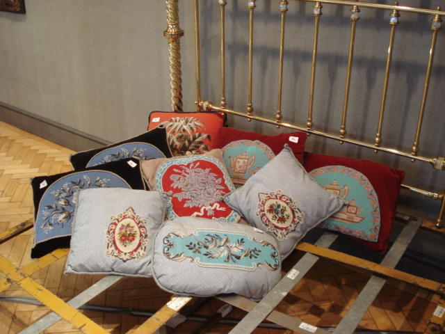 A collection of nine various beadwork cushions
