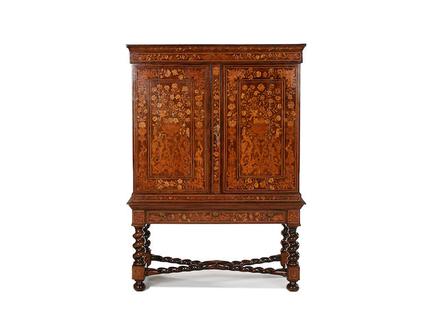A first half 19th century Dutch walnut and floral marquetry cabinet on stand