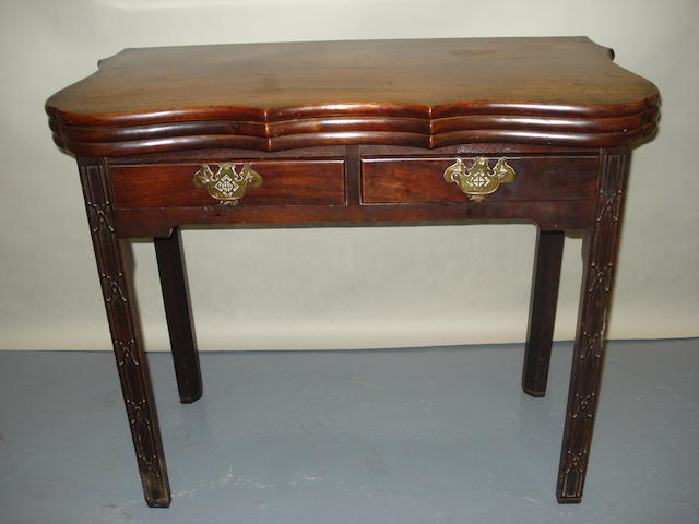 A George III mahogany triple foldover tea and games table, parts of later date, 86cm wide.