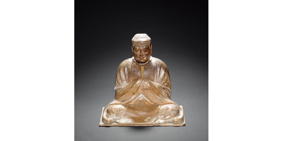 A sectional wood sculpture of a seated male holding a Shaku (ceremonial tablet), possibly intended as The Shinto Deity, Hachiman-shin Probably Edo Period