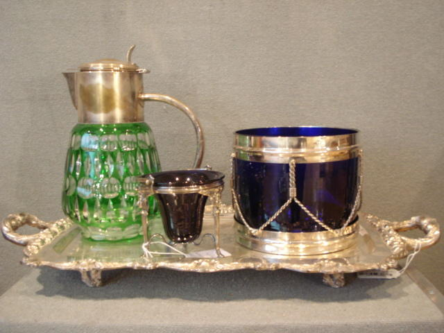 A silver plated and blue glass lined ice bucket in the form of a drum together with three other pieces
