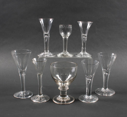 Six plain bowl wine glasses, a cordial glass and a rummer Late 18th Century.