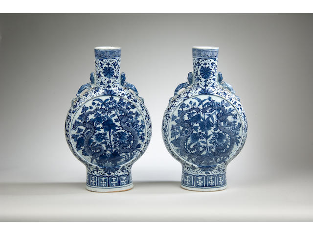 A fine pair of Chinese blue & white moonflasks, Qing dynasty, 19th Century in date,