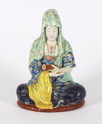 A Chinese porcelain figure of a seated lady Early 20th Century.