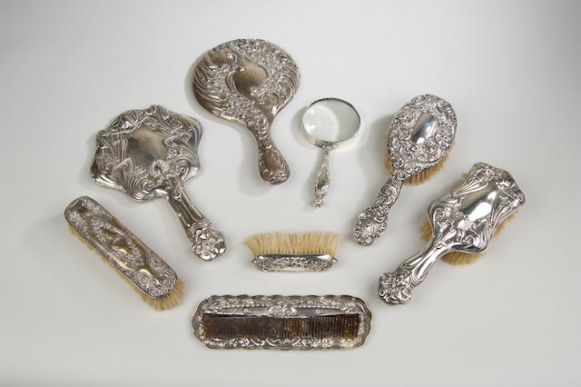 An Edwardian Art Nouveau silver backed hand mirror, Chester 1902,